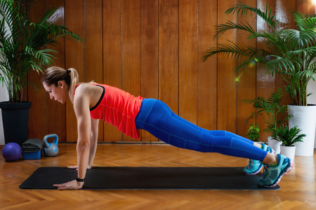 Woman doing High-intensity interval training at home. Woman Doing High Plank Exercise
