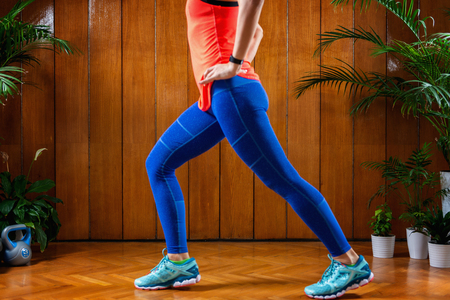 Woman doing High-intensity interval training at home