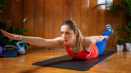 Woman doing back extension on High-intensity interval training at home.