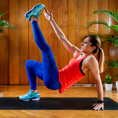 Woman doing High-intensity interval training at home Banco de Imagens