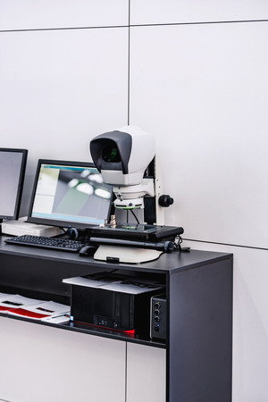 Combined video measuring system and ergonomic measuring microscope for automotive, aerospace, medical devices.