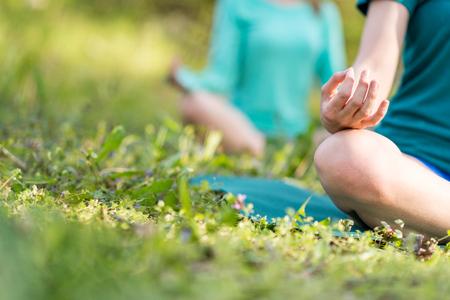 Yoga detail, lotus position mudra.