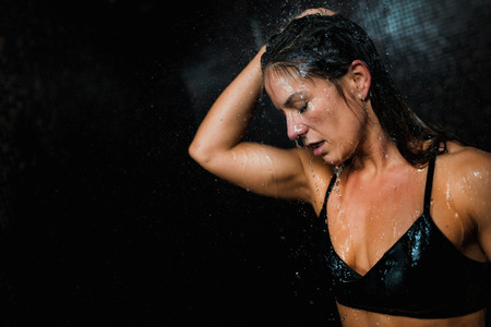 Beautiful Woman Taking a Shower after Spa Center Sauna. Banco de Imagens