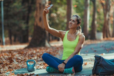 Woman Making Selfie After Training Outdoors Imagens
