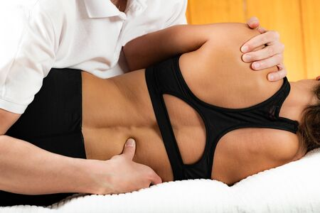 Osteopathist Treating Female Patient's Spine