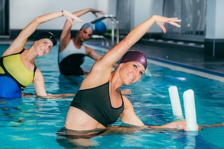 Group of Women with Female Instructor, Water Aerobics Class. 版權商用圖片