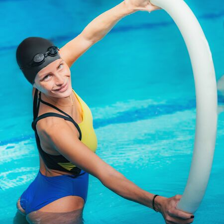 Female Aqua Aerobics Instructor.