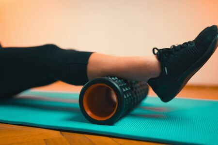 Woman Using Foam Roller for Fascia and Muscle Massage