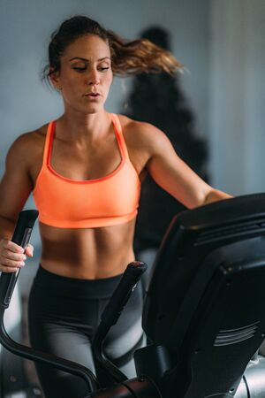 Woman Exercising on Elliptical Cross Trainer