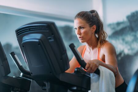 Woman Exercising on Cycling Machine