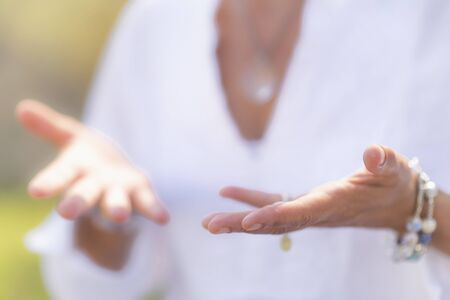 Gratefulness – Woman expressing gratitude with hands. Close up image of female hands in prayer position outdoor. Self-care practice for wellbeing