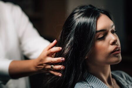 Woman getting a new hairstyle.