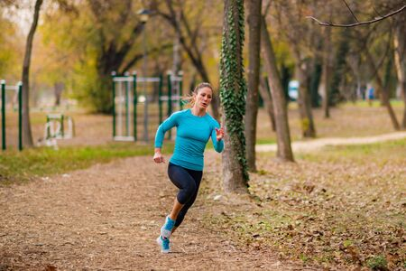 Woman Jogging Outdoors in Park. Nature, park, yellow background
