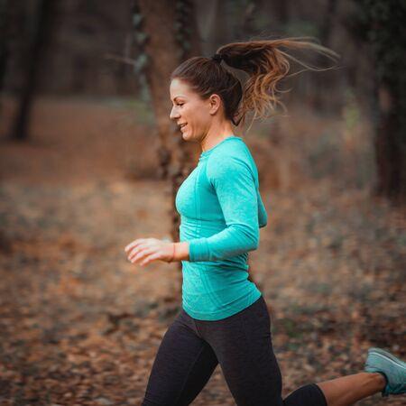 Attractive Woman Jogging. Nature, Outdoors Reklamní fotografie - 140367553