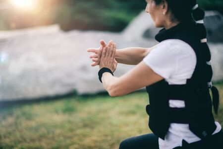 Chi Gong energy practice. Mature woman exercising in a park. Stock Photo