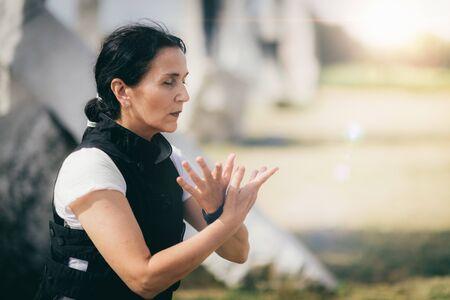 Qi Gong energizing exercise outdoors.