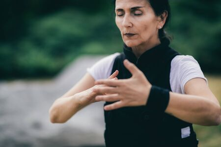 Woman practicing Qi Gong in the park