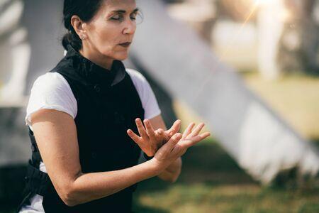 Qi Gong energizing exercise outdoors. Stock Photo