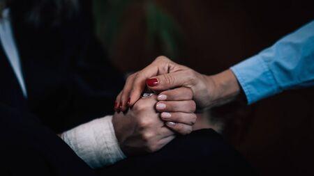 Positive Psychology. Professional therapist holding patient's hand, enforcing flow of positive emotions Banco de Imagens