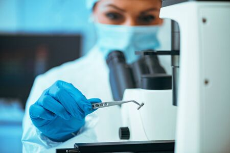 Researcher Working with Chip Implants in Laboratory