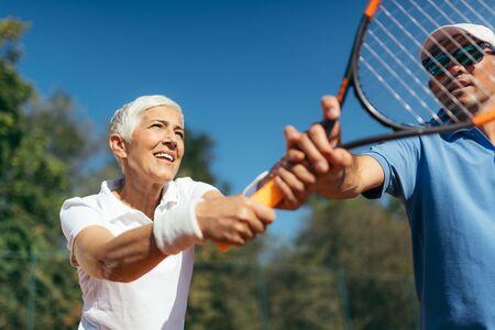 Mature Woman Playing Tennis Zdjęcie Seryjne