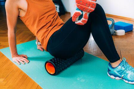 Foam Roller Gluteus Massage Banque d'images