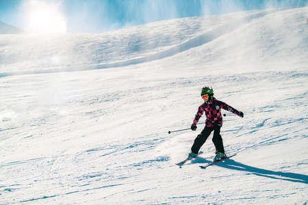 Cute Boy Having Fun Skiing in the Mountains