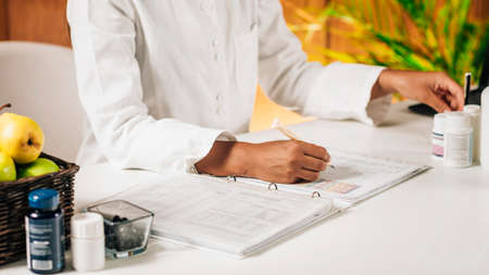 Functional medicine practitioner giving personal health report to the client