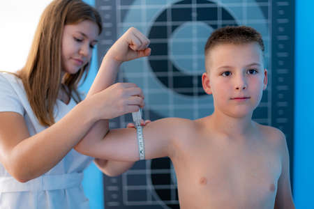 Muscle strength and volume analysis in children, anthropometric upper arm circumference tape measurement