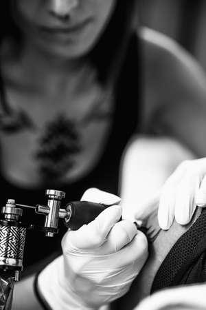 Tattooing process in a tattoo studio