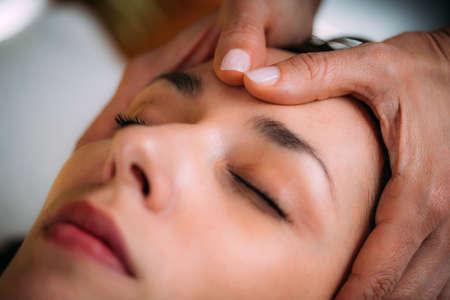 Craniosacral Therapy Massage. CST therapist Massaging of Woman's Head.