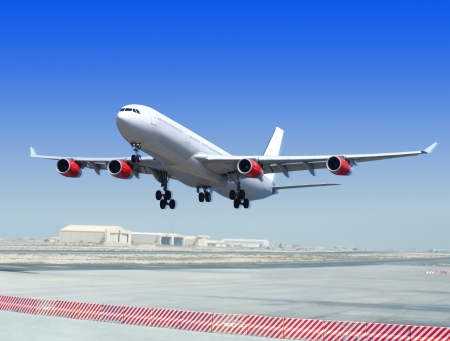 big flying up passenger airplane on airport background Stock Photo