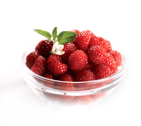 Assorted berries in bowl on natural background. Selectve focus