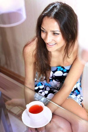 young beautiful woman is having her morning tea