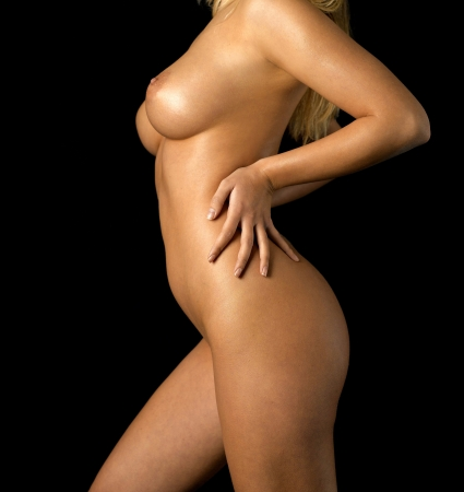 abdomen of nude young woman in front of black background Stock Photo - 12865043
