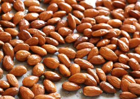 Close up of the whole almond nuts which are fried for background
