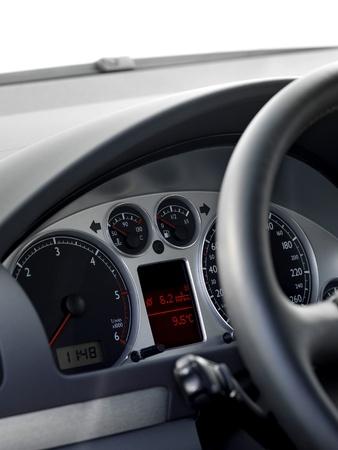 Modern car illuminated dashboard closeup, tachometer photo