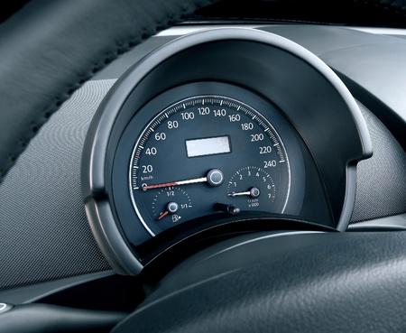 Modern car illuminated dashboard closeup, tachometer