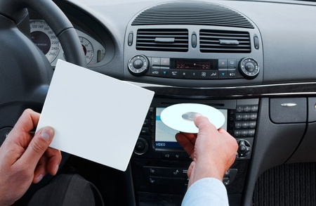 interior of modern european car, hands with disc photo