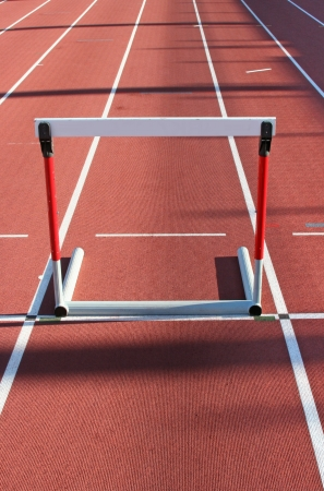 red running tracks with three hurdles set up for training  photo