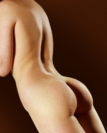 nude female buttocks: part of sensual woman isolated in black studio  Stock Photo
