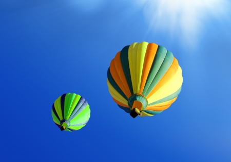 colorful soar hot air balloons on blue sky