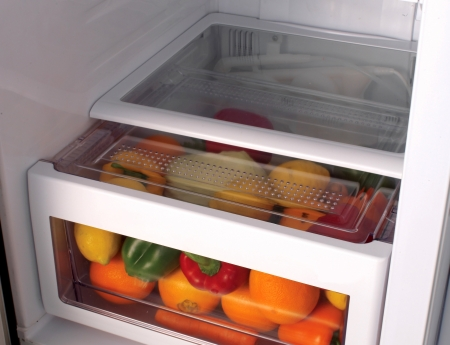 Fresh fruit and vegetables in the fridge Stock Photo