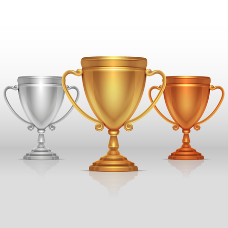 Gold, silver and bronze winners cup, goblet vector. Set of sports trophies to the winners illustration Illustration