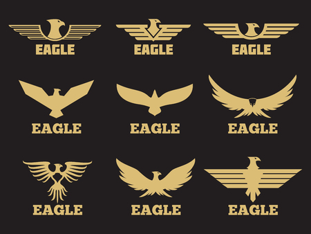 Gold heraldic eagles logo collection on black background