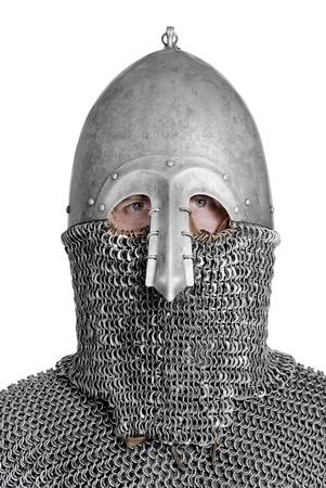 hauberk: portrait of viking or slav with hauberk and helmet, isolated on white background. Stock Photo