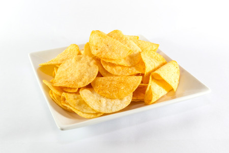 Close up potato chips on white dish