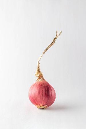 Close up red onion on white background
