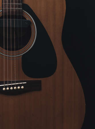 Close up sound board and strings of old acoustic guitar and dark tone vintage filter