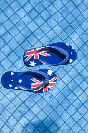 Pair of sandals printed with the Australian flag floating on a pool.
